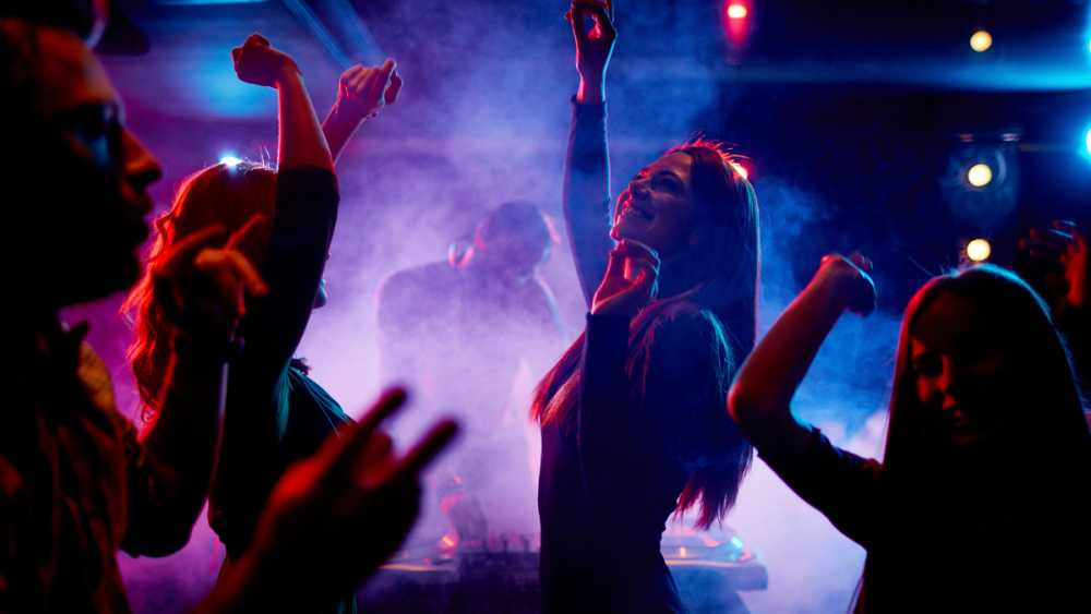Group-of-dancing-young-people-enjoying-night-in-club.jpg