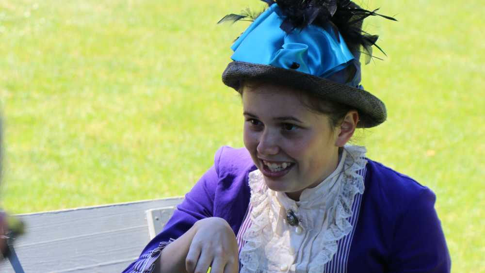 A Victorian Lady playing games at Fort Mackinac.