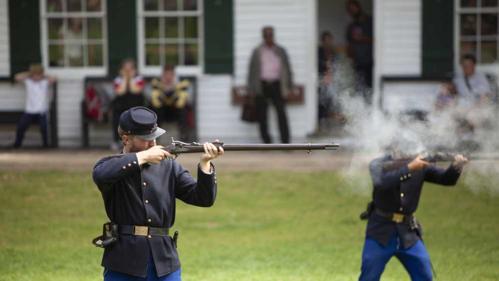 A Rifle Firing demonstration, on the parade ground inside iconic Fort Mackinac.