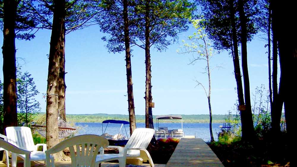 Our private lake frontage - free kayaks, pontoon boat and paddle boat.