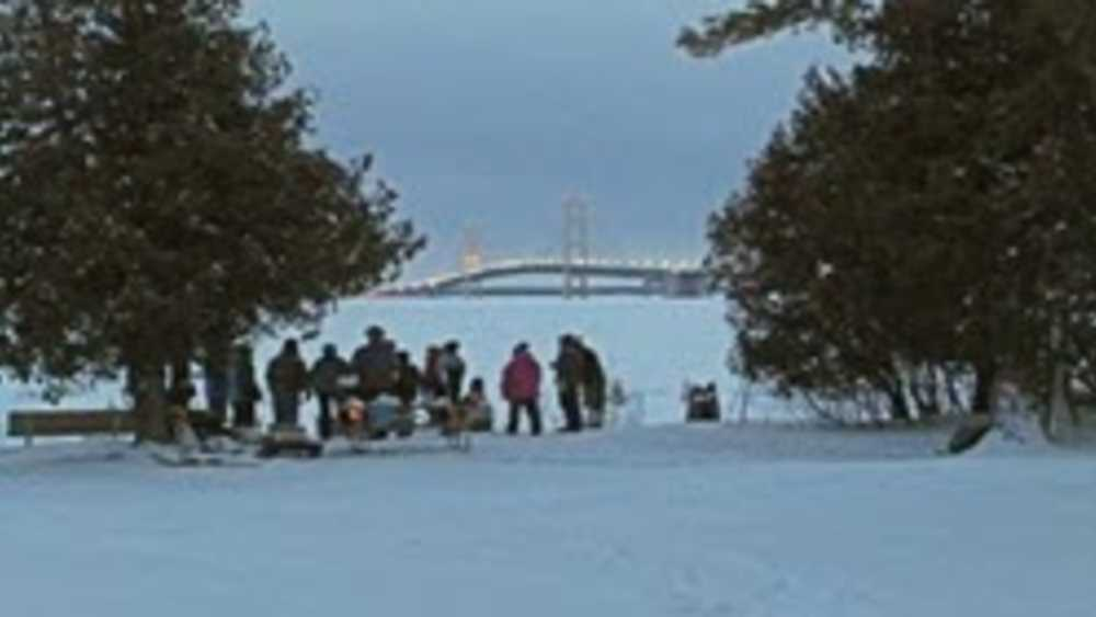 DNR, Straits State Park, snowshoers overlooking the Mighty Mac