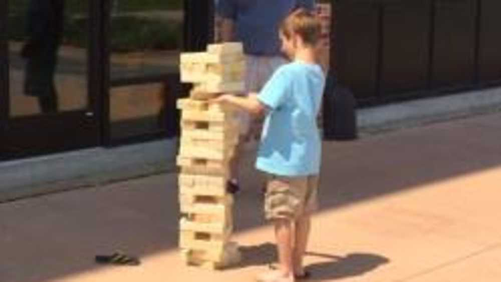 boy playing giant Jenga