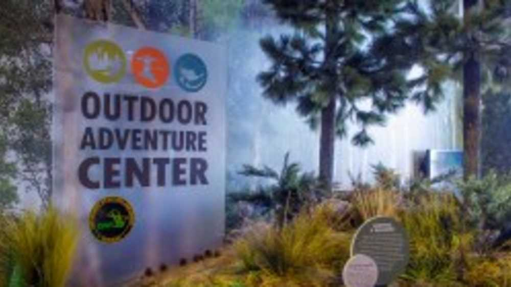 Outdoor Adventure Center logo on indoor sign