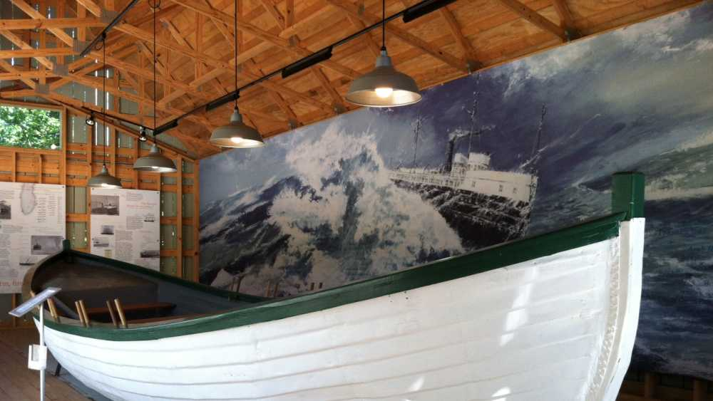 This restored Francis Metallic Surfboat is centerpiece of our shipwreck exhibit at the Old School House.