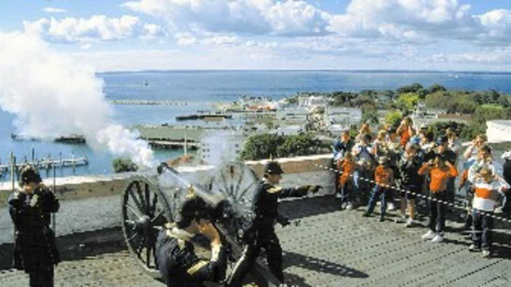 Cannon being fired at Fort Mackiac
