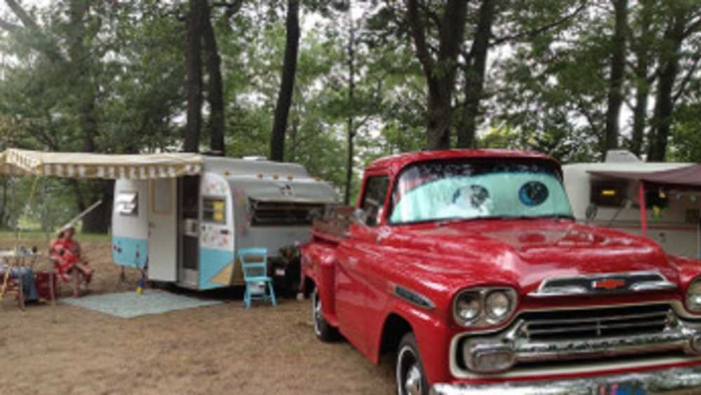 Vintage trailer and pick-up truck on campsite at Port Crescent State Park