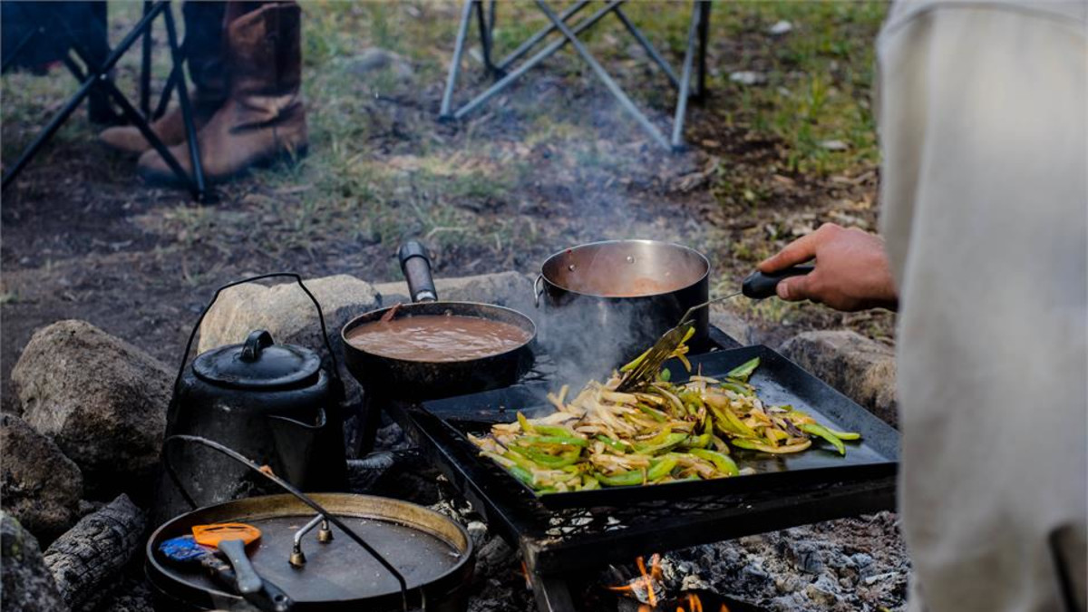 Amazing camp cooking over an open fire