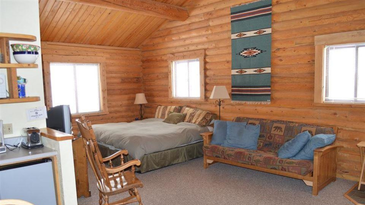 Aspen north has a king bed, double futon, full kitchenette, and full bath.  It adjoins the Aspen south cabin and can be rented as a single unit or with the Aspen south cabin.