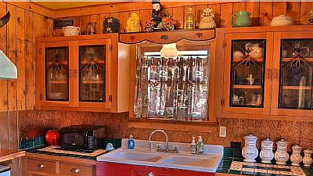 Vintage Kitchen with updated amenities; coffee/expresso maker, stove, oven, microwave, fridge, tea kettle and all needed utensiles