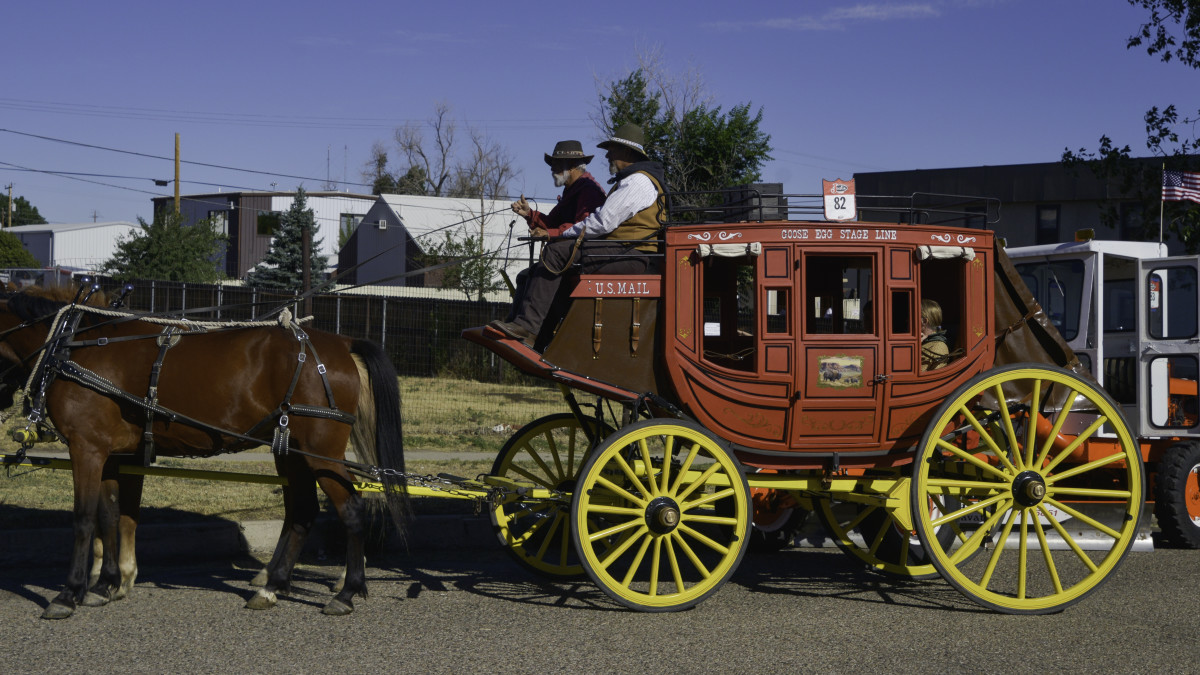 Kim and Bill on parade day w stagecoach from Al Kalabflesh 2017 email.jpg