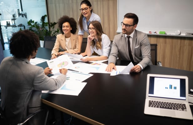 Business colleagues having meeting in conference room in modern office