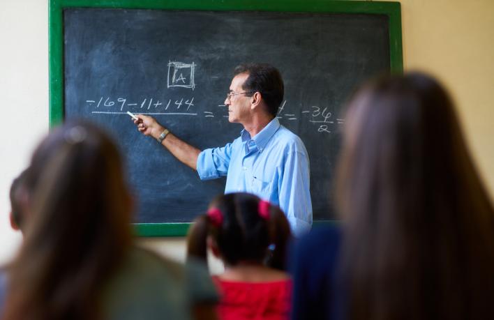 middle-aged-teacher-during-math-class-at-high-PZAFU4D_Crop