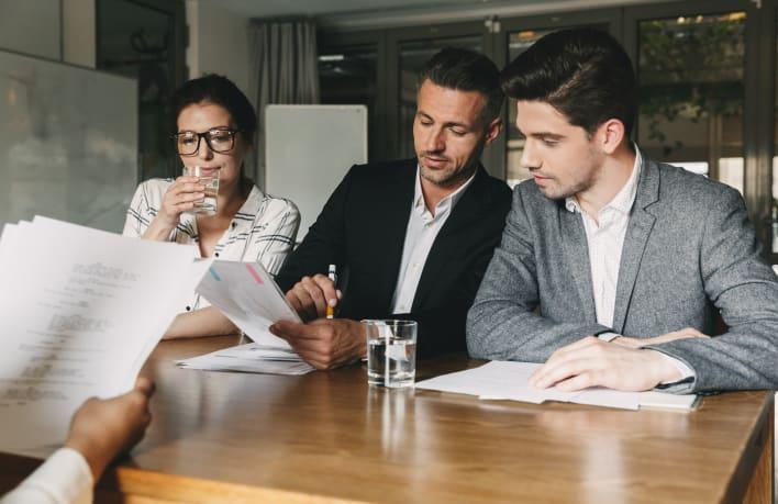 group-of-caucasian-employers-in-formal-wear-ZWUDPHG_Crop
