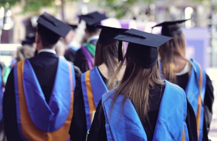 university-graduates-at-graduation-ceremony-SBWDA8G__1__Crop