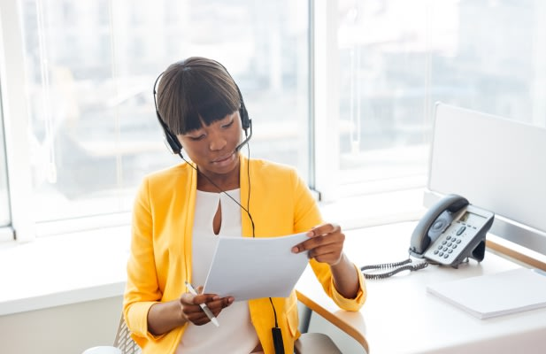 Afro american businesswoman working in call center