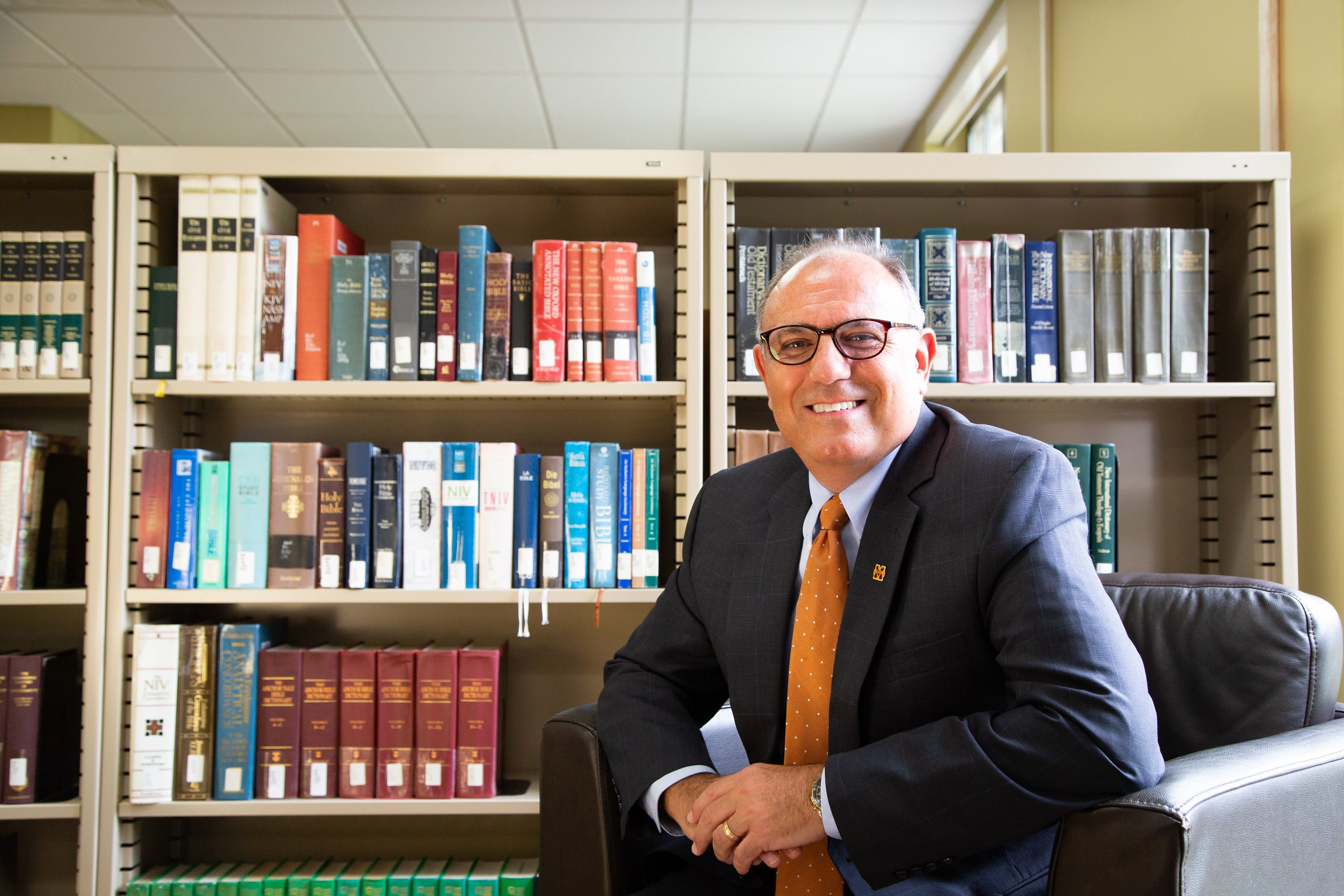 President Greer sitting in the library