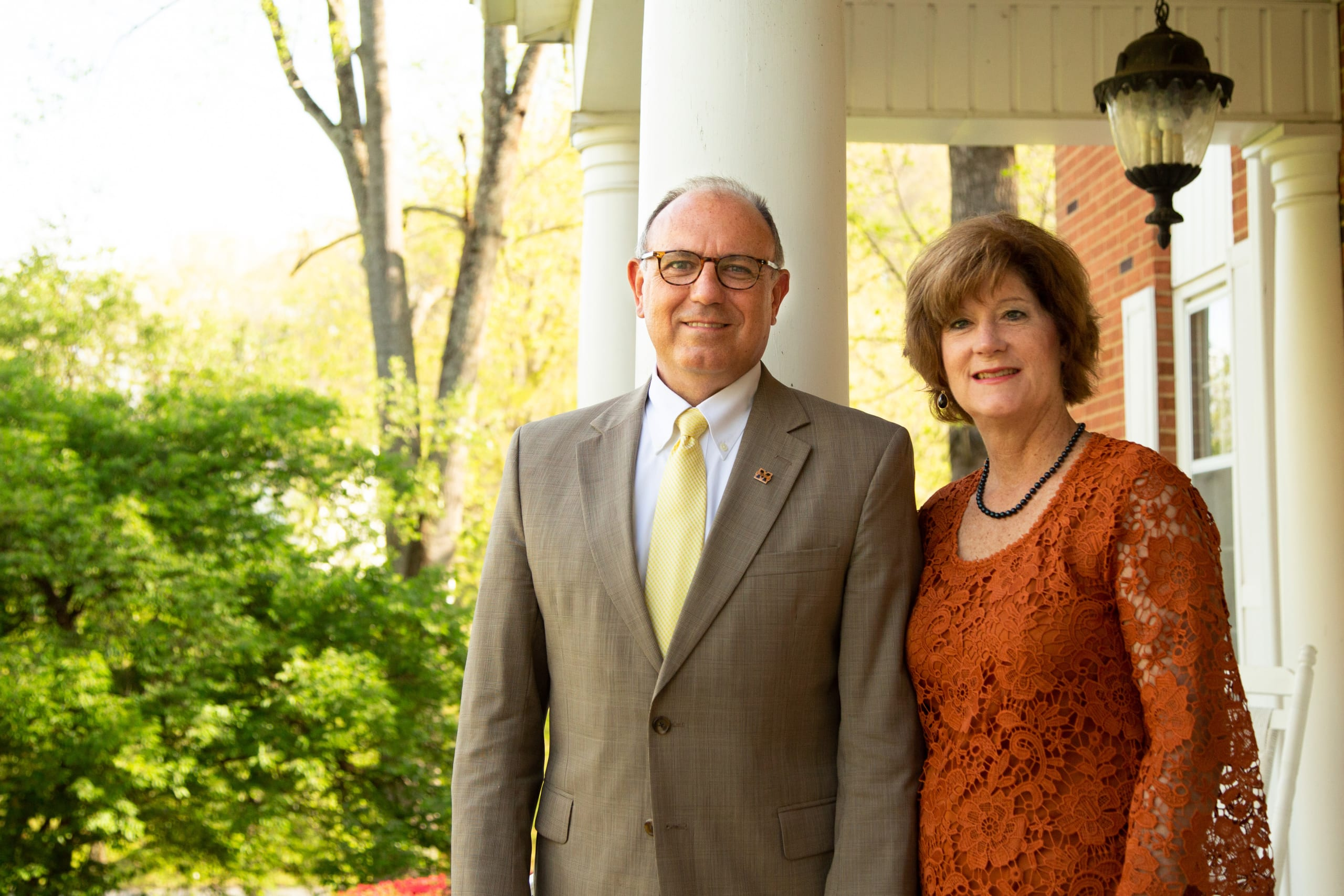 President and First Lady Bill and Edwina Greer in front of Milligan University's Little Hartland Welcome Center.