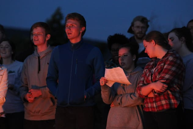 Students at an outdoor Vesper service