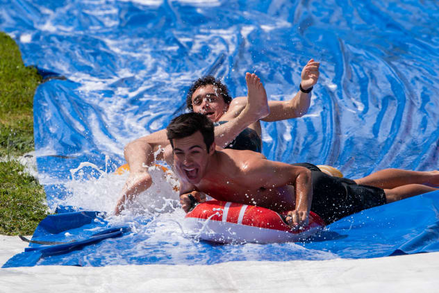 Students on a water-slide