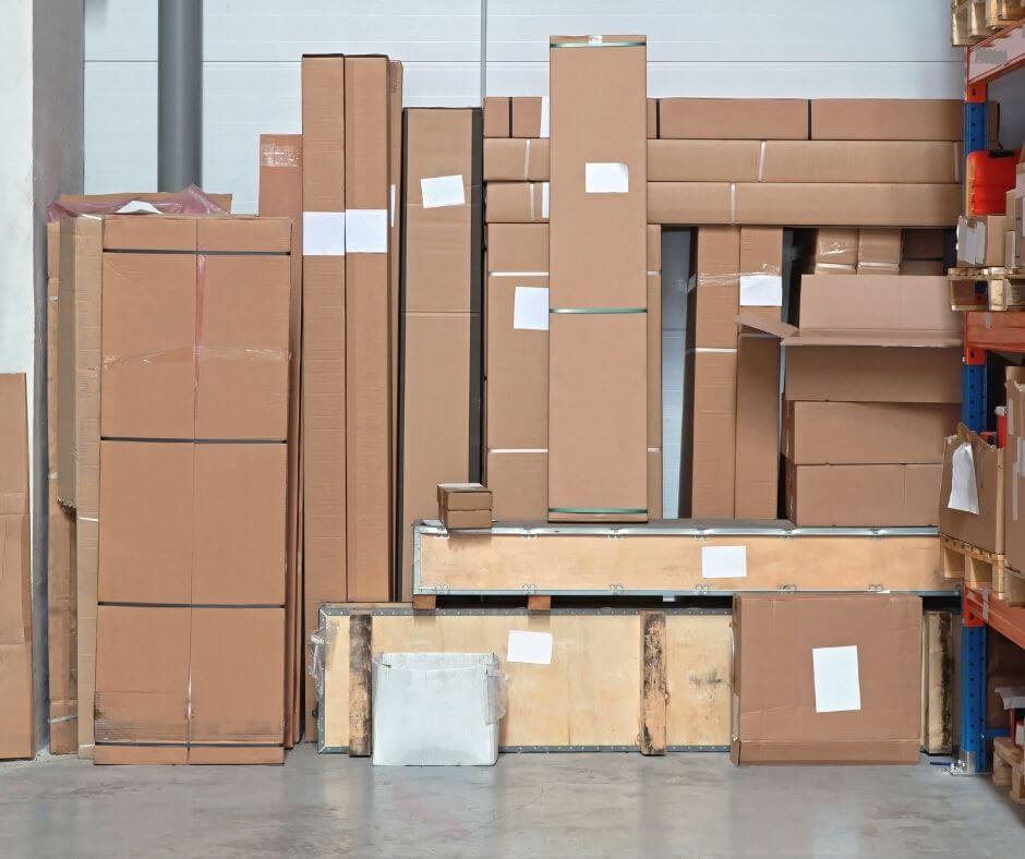 boxes of various sizes stacked along a wall
