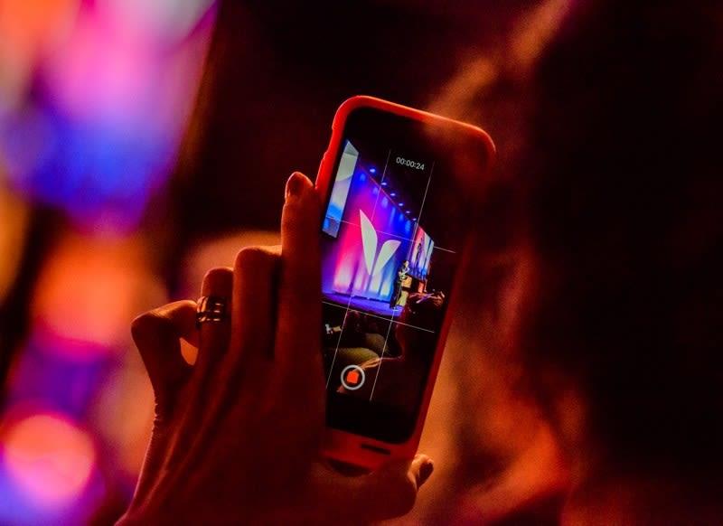 Mindvalley student using a mobile phone at Mindvalley U Tallinn 2018