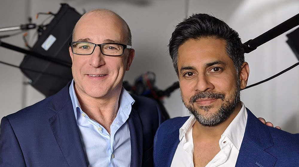 Paul with Vishen filming in a studio, in London