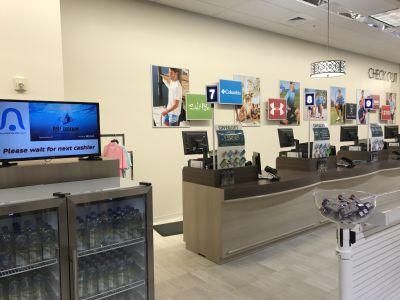 Qbuster Call Forward at a checkout counter at Marshalls.