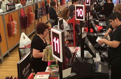 Qbuster Call Forward at a checkout counter at T.J.Maxx.