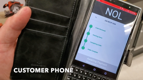 Customer phone with order tracking details shown.