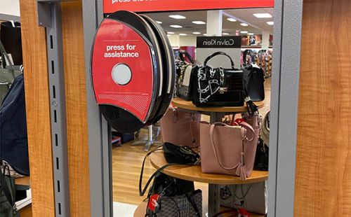 Press for assistance button in handbags department.