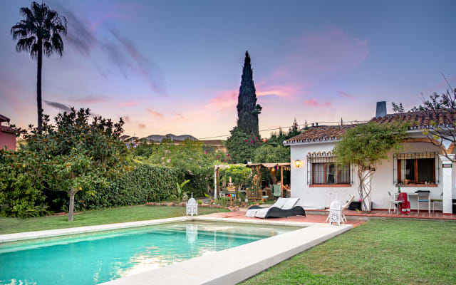 Large villa with pool, fireplace and Andalusian style garden.