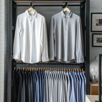 A wall display of racks of dress shirts.