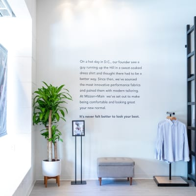 A wall of the store, featuring a brief printed history of Mizzen+Main.