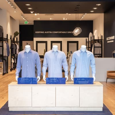 The main entrance to the store, featuring three mannequins wearing Mizzen+Main dress shirts.