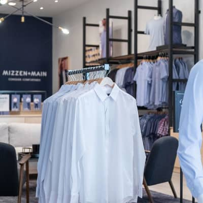 The interior of the store, showing displays of dress shirts on racks.