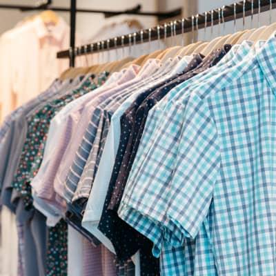 A closeup shot of a rack of shirts on hangers.