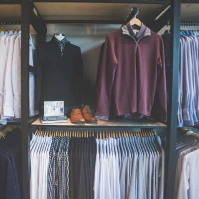 A wall of the store, displaying racks of clothing.