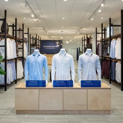 The main entrance of the store, featuring three mannequins wearing Mizzen+Main dress shirts.