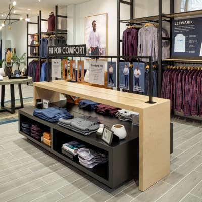 The center display of the store, featuring neatly-folded dress shirts.
