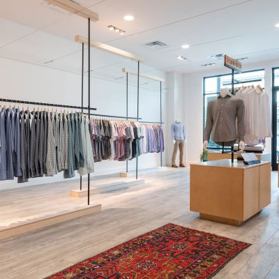 The interior of the store with racks of clothing.
