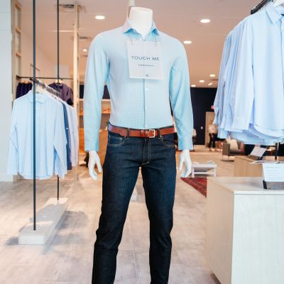 A full-size mannequin wearing a Mizzen+Main dress shirt, with a sign saying,