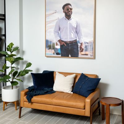 The store's lounge area, with a large photo of a model wearing Mizzen+Main.