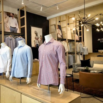 Three mannequins displaying our dress shirts at the entrance to the store.