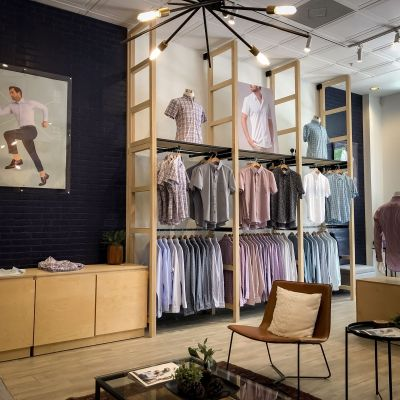 The wall of our West Village store, showing displays of our shirts.