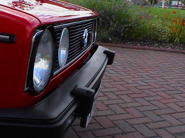 h front bumper showing 2 head lamp washers.jpg