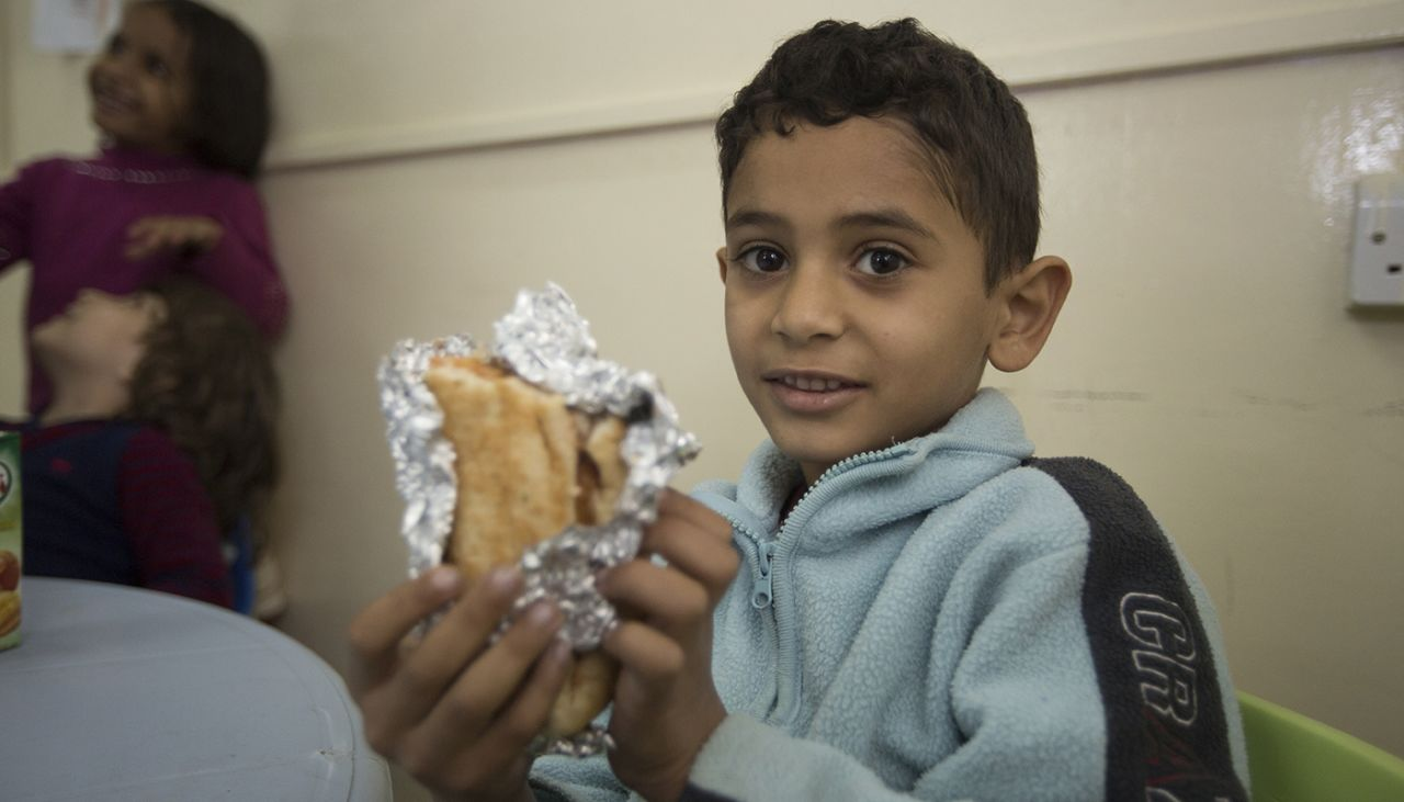 5-year old Jalel shares his food with hungry parents