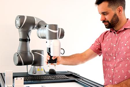 Man working with OMRON collaborative robot