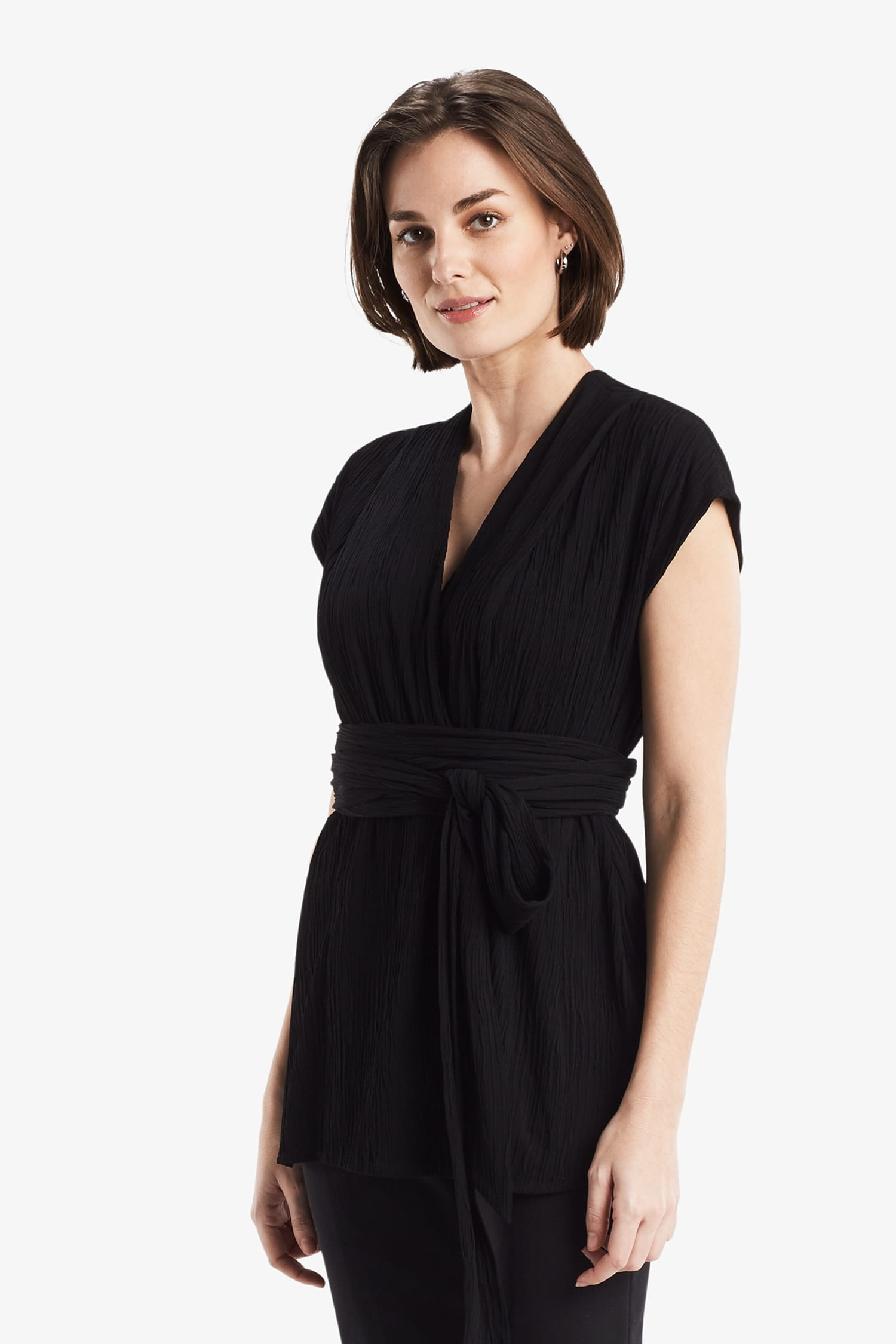 add372d1b0ac Side image of a woman standing wearing the Valerie Top in black