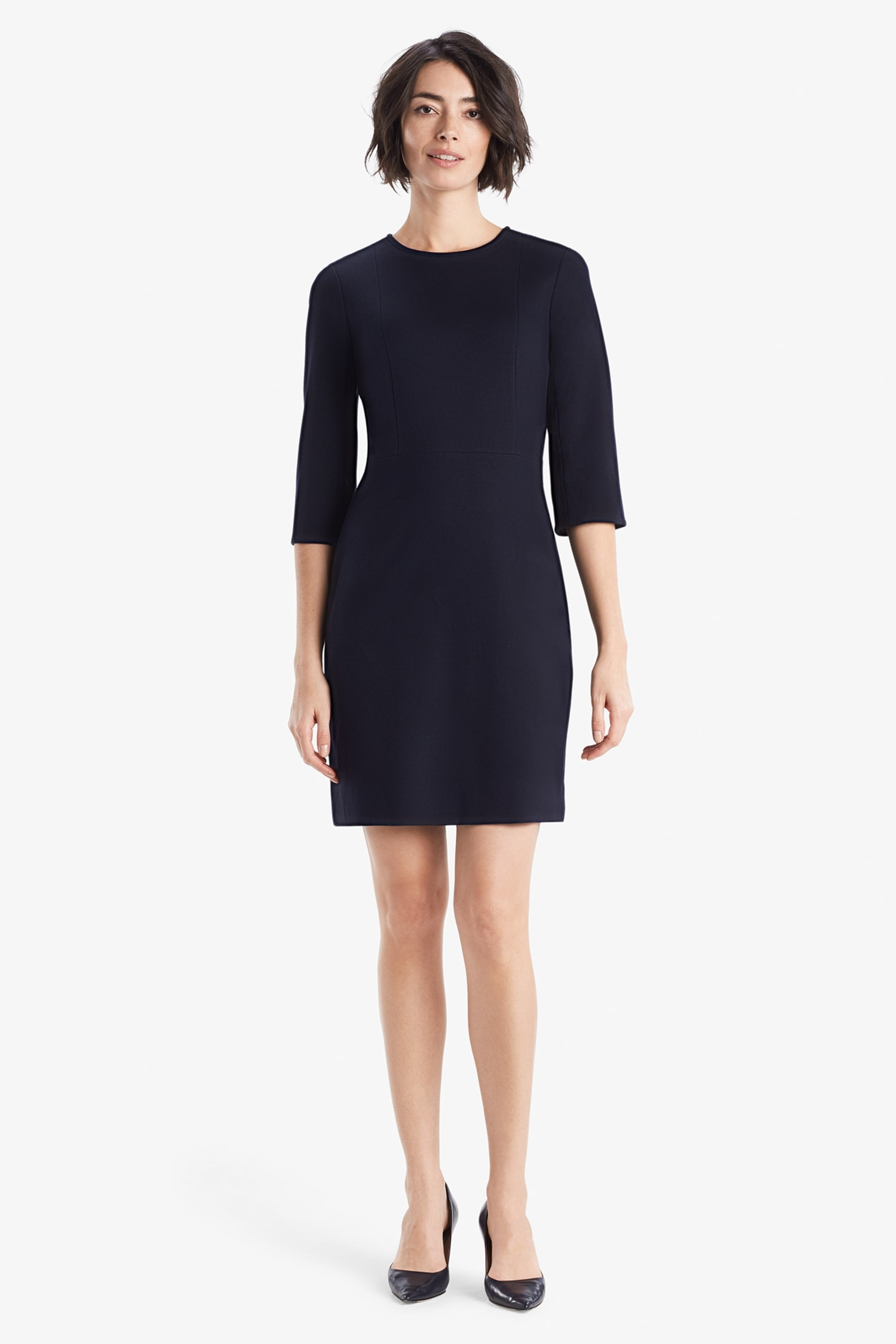 a0ee7fb87ab5 Front image of a woman standing wearing the Lena dress in galaxy blue