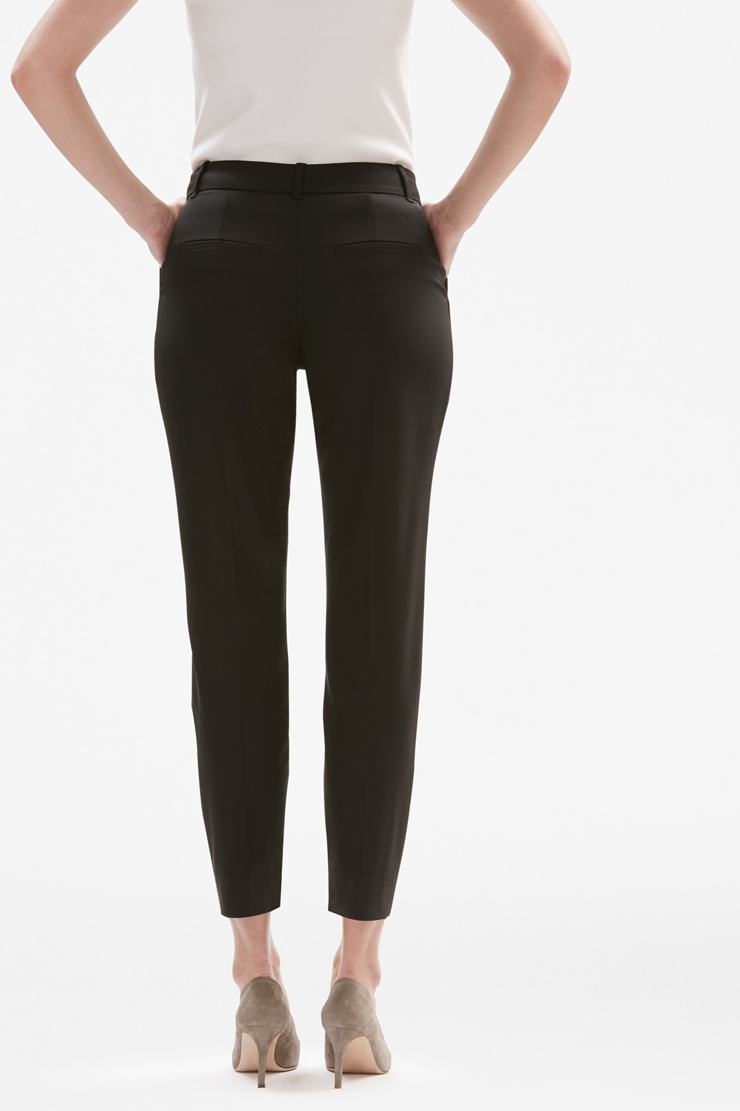 aa9146ead02de Back image of a woman standing wearing the Mejia pant in black